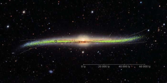 Obraz galaktyki z zakrzywionym dyskiem. Kropki odpowiadają położeniom cefeid w Drodze Mlecznej (J. Skowron / OGLE / Obserwatorium Astronomiczne UW)